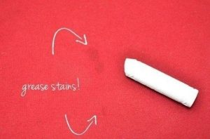 grease stains with a piece of chalk